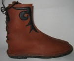 center-seam bullhide tie-back boot